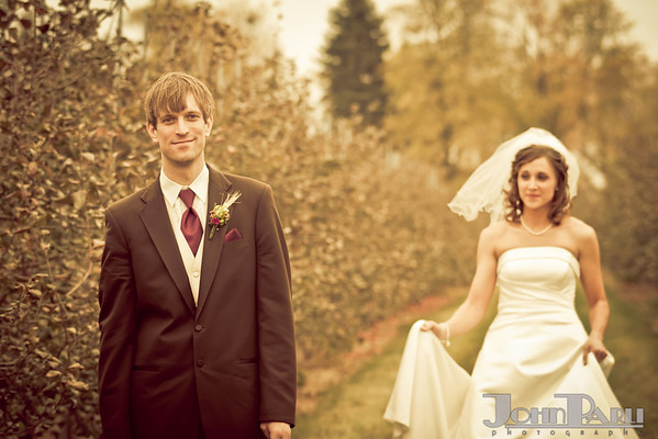 groom and bride portrait with bride behind