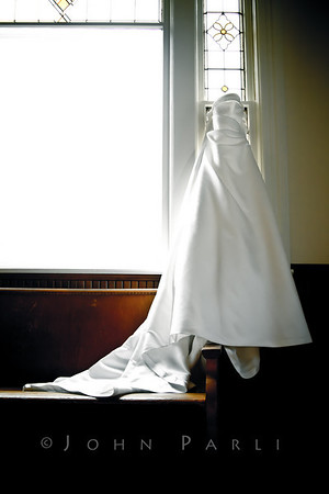 bride's wedding gown hanging in church