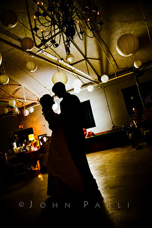bride and groom first dance backlit