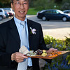 Mr. Lau with a plate of the yummy hors d'oeuvres