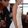 John checks out something in the back of Ann's dress