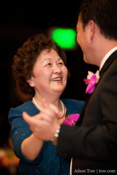 John's mom dances with John