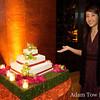 Rae next to the wedding cake