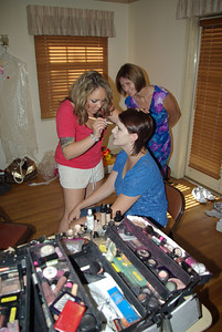 THE TRANSFORMATION CONTINUES - Anna gets ready as her mom looks on.