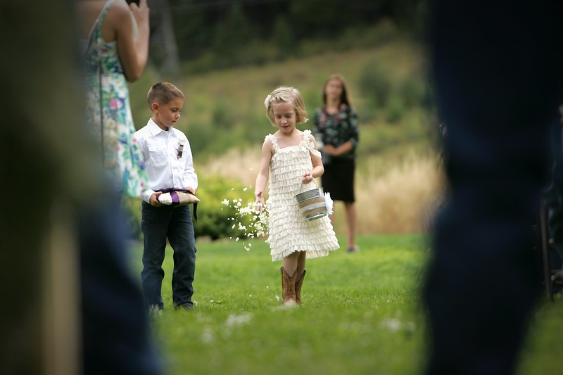 pouring her heart into her job as flower girl