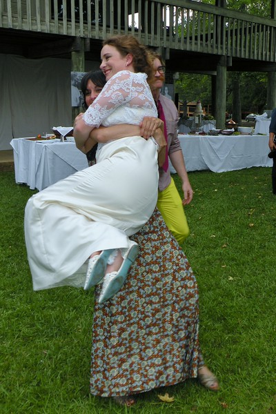 May 2016 A fun pic of the bride jumping into the arms of her friend