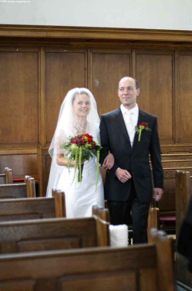 The bride and groom entering the church