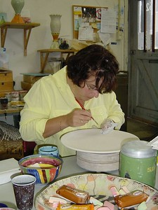 It was my choice which ceramics we would be painting. I choose a pastry set. Being the bachelorette, I got to work on the big cake plate. Starting with the bottom side allowed us to proactice a bit.