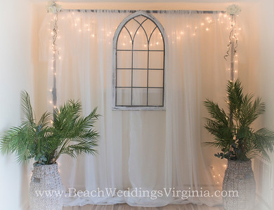 "the ""traditional"" wedding arch inside the Bayside Wedding Studio"