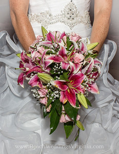 stargazer lilies, pink spray roses, baby's breath. Cascading style