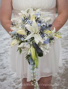 White lilies, blue accents, cascading style