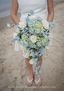 Blue hydrangeas, blue delphinium, white roses, baby's breath. Cascading style