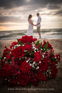 red roses, red peruvian lilies, red carnations and baby's breath in cascading style