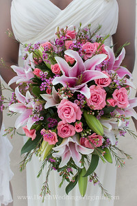 Stargazer lilies and other pinks, lavender. Cascading style