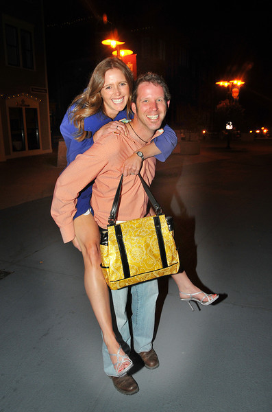 In true chivalarous fashion, groom Scott carries bride Becky to a pre-wedding reception. (c) 2011 Tom Kelly