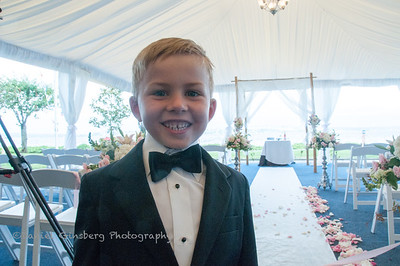 Boy in tuxedo early awaits an upcoming wedding.