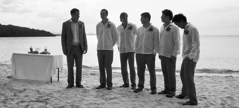 groom and groomsmen waiting for bride and bridesmaids