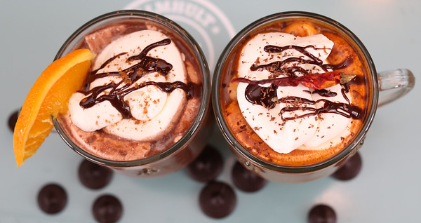 Hot chocolates made with Euphoria dark chocolate buttons and the ultra sauce drizzled on top.  [Kelly Lyon/The Register-Guard] - registerguard.com