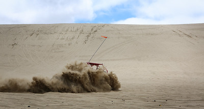 Kyle Boettger's sand car gets enveloped with sand near Florence Oregon.  (Kelly Lyon/The Register-Guard)