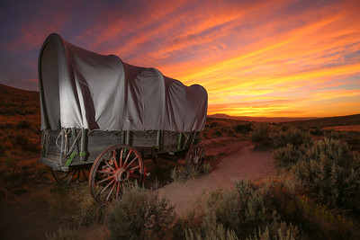 An wagon sits along the Oregon trail near Baker City's National Historic Oregon Trail Interpretive Center.  (Kelly Lyon/The Register-Guard)