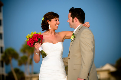 "Betsy & Ryan say ""I do"" at the Lido Beach Resort in Sarasota. www.lidobeachresort.com Photos by Dara Caudill www.islandphotogaphy.org  Music by Chuck Caudill www.chuckcaudill.com  Flowers by The Flower Girls, www.sarasotaflowergirls.com Dr Stephen Lortz officiated www.weddingsinsarasota.com.  Makeup by Tammy Gamso www.tammygamso.com  Wedding cake by Cakes by Ron www.cakesbyron.com  Betsy & Ryan's wedding is featured in the winter edition of Nuovo Bride www.nuovobride.com"