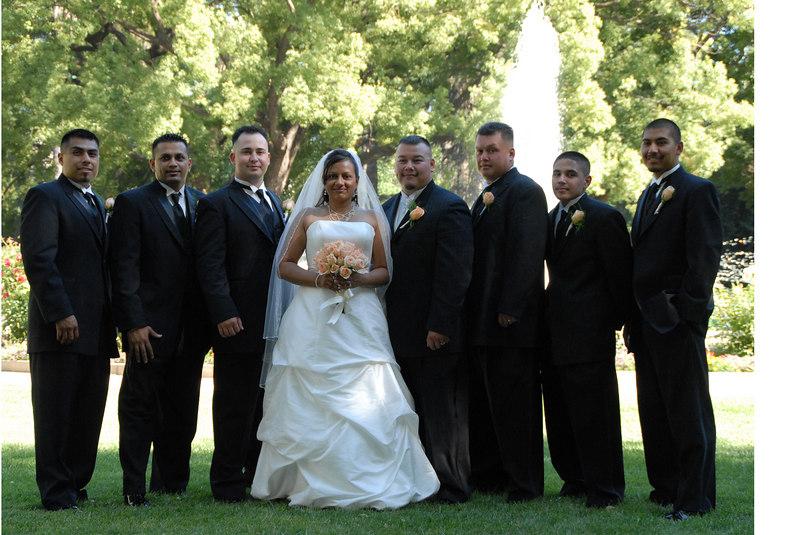 bride and groom w groomsmen