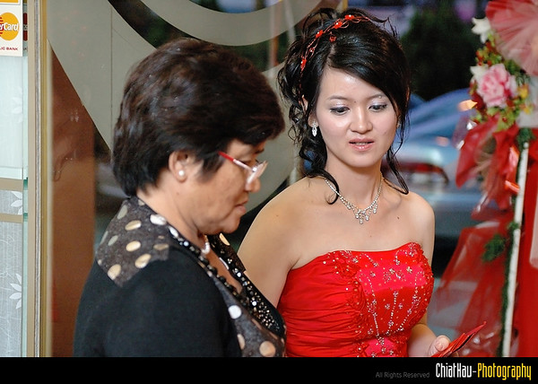 Lee Fen and her mom discussing...