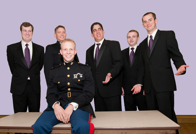 Brad on table with groomsmen