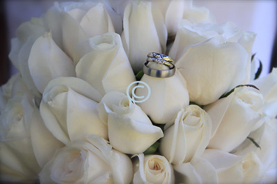 White roses often gets lost in the hot sun of an out door wedding.  They work best for an indoor wedding.  If white complements your skin.  A bud bouquet.