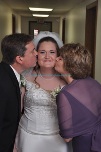 wedding, bride, parents, kiss