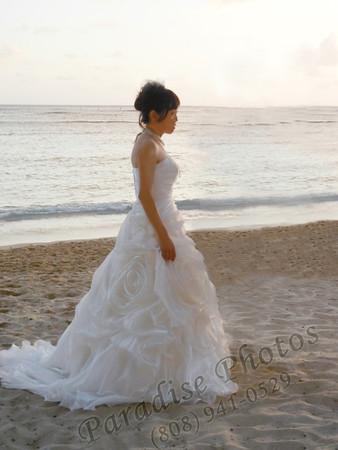 Tokyo bride  in Waikiki (erased husband and before diam Head background)