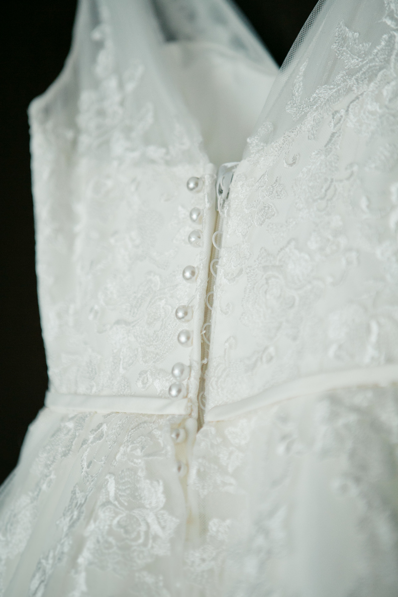 wedding dress with delicate lace and buttons coming down the back