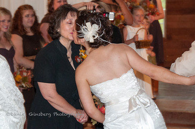 A quick kiss to her mother as she walks down the aisle.