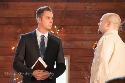 Minister Reverend Adam Barringer talks with groom Justin Taylor before the ceremony starts.