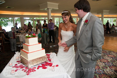 I don't think Caitlin really wants to cut the cake.