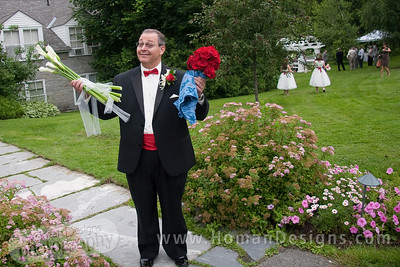 The father of the bride with his hands full.