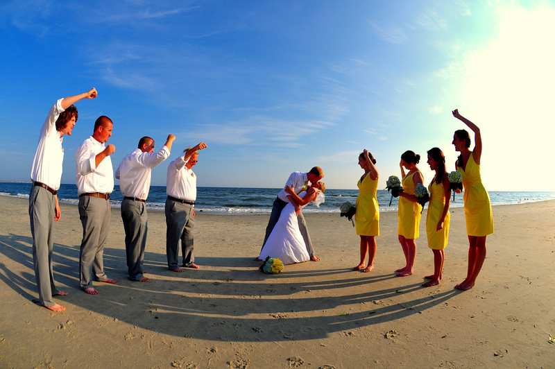 Bryce Lafoon photographs a bride and groom kissing on the beach of Oak Island, North Carolina.