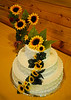 Wedding cake and sunflowers at wedding reception for Charlotte Erickson and Brandon Eames along the Rock River near Dixon, Illinois, on July 31, 2010. (c) 2010 Tom Kelly