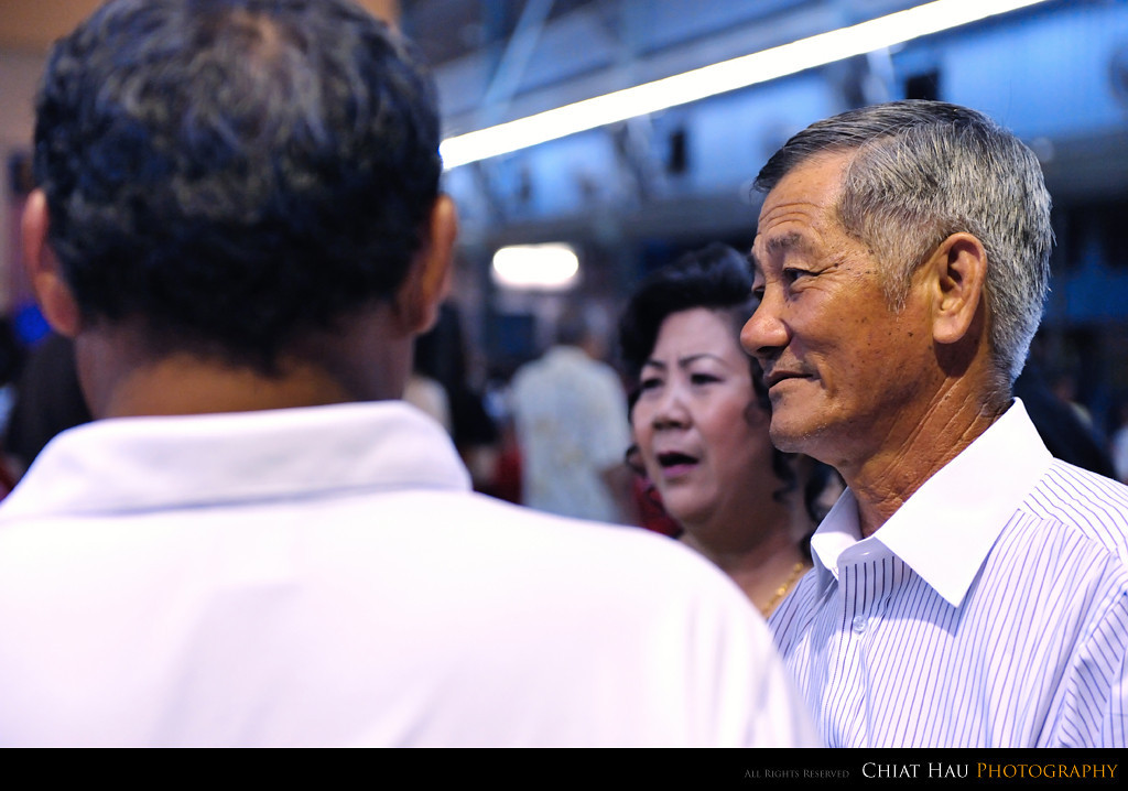 Fang's dad having a chat with the guest