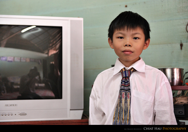 Fang's brother son (aka the door welcoming boy) :)