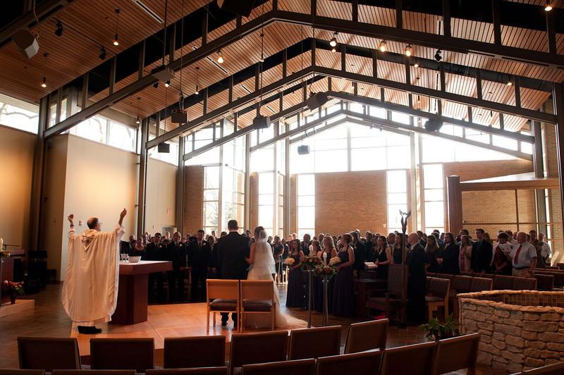 Wedding of Cheryl and Paul. St. Thomas More Catholic Student Parish, Kalamazoo, Michigan. Reception held at Father Bart Memorial Center social hall, St. Mary Catholic Church.   Copyright Anthony Dugal Photography, Kalamazoo, Michigan, USA, (269) 349-6428.