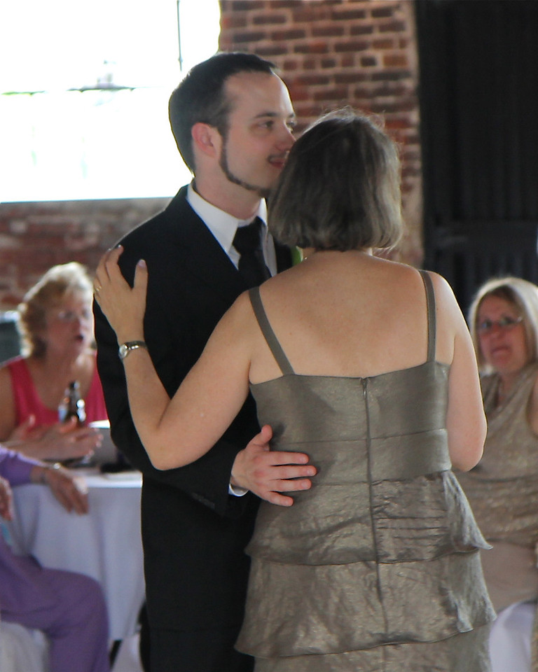 "Groom and mom (Donna Pipkin) dancing to ""Teach Your Children Well"" by Crosby, Stills, Nash & Young."