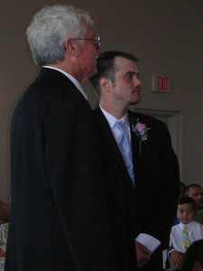 Father and Son wait patiently for the bride.