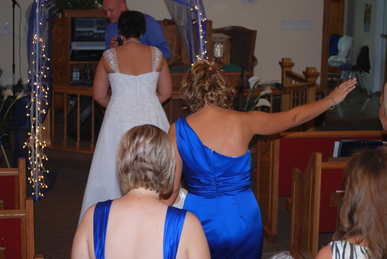 A different angle on throwing the bouquet.
