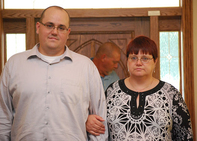 Timmy escorting his mom into the church.