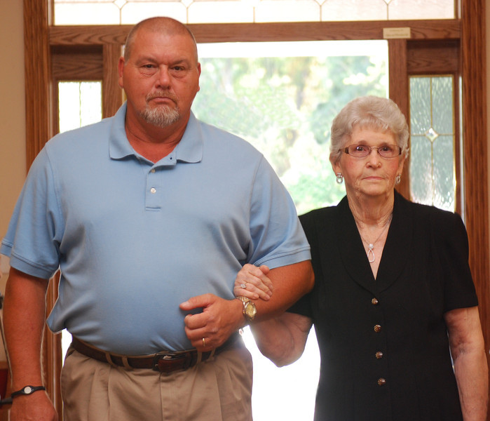 Paul Clark escorting his mom into the church.