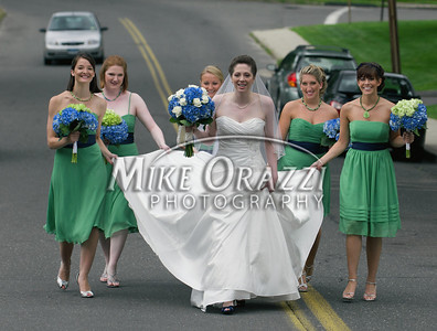 7/24/2009 Mike Orazzi | Staff Bride to be Kelle Contrastano walks on Queen Street in Bristol with her bridesmaids while on her way to marry David Barrieau at St. Joseph Church on Friday evening. Contrastano decided to walk the 663 feet from her parent's home and skip a limo ride saying she did while she attended the St. Joseph School so doing it on her wedding day didn't seem like a big deal.