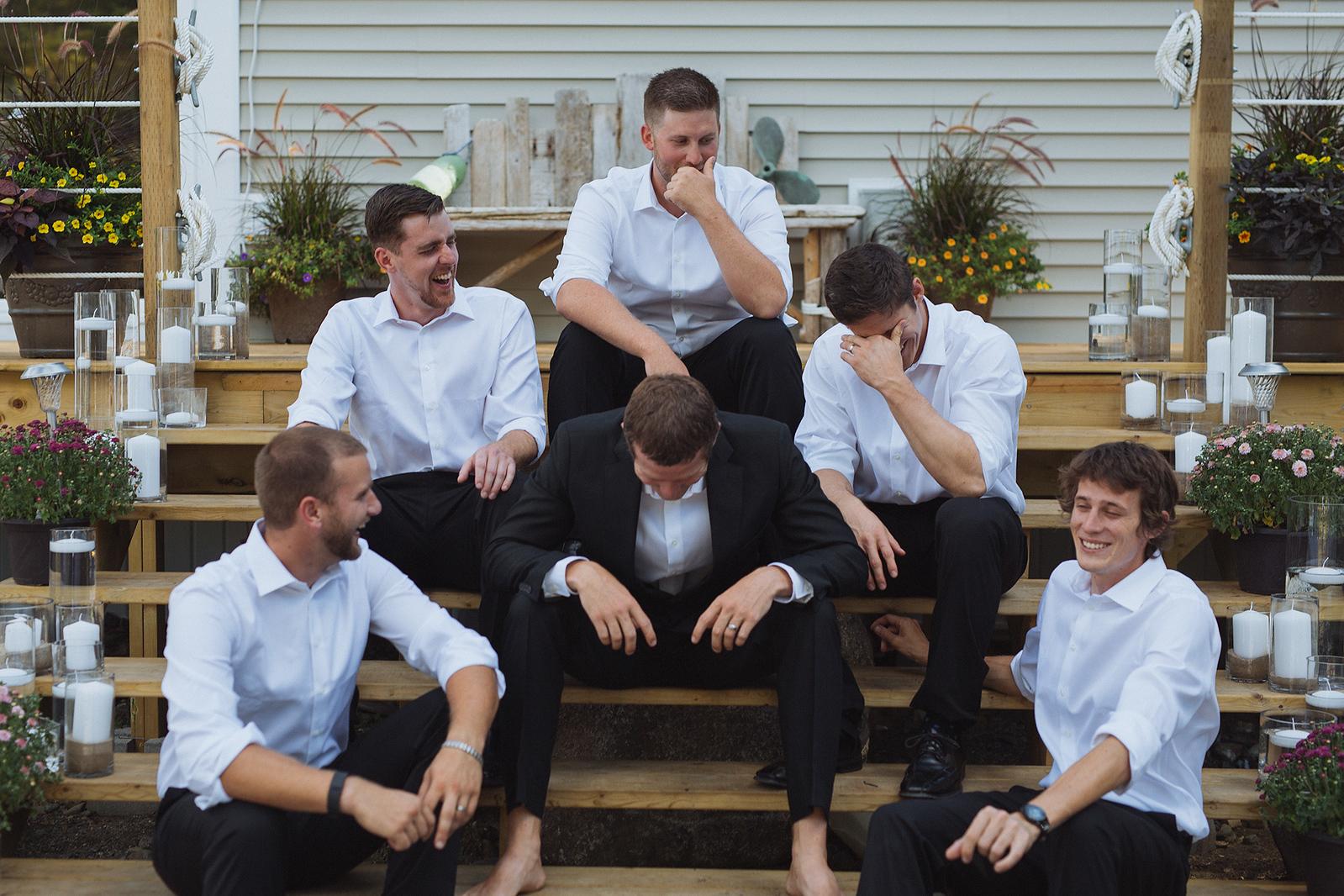 Groomsmen laughs