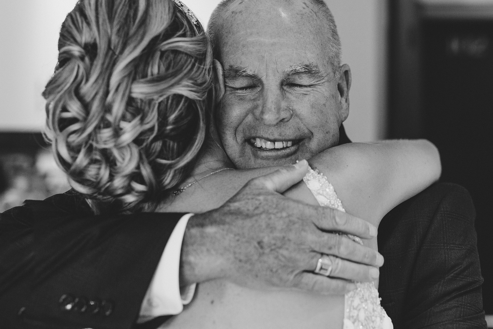 Dad and daughter embrace