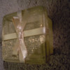 gold present mesh container, 50 cents. 1 available.